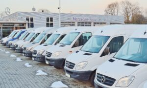 Line of dealer stock white commercial vans for commercial vehicle leasing