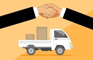people shaking hands over fleet leasing deal for delivery van